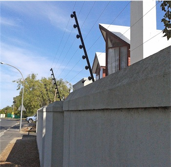 electric fence on top of a wall