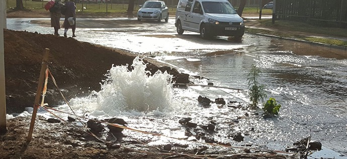 Burst water mains in street